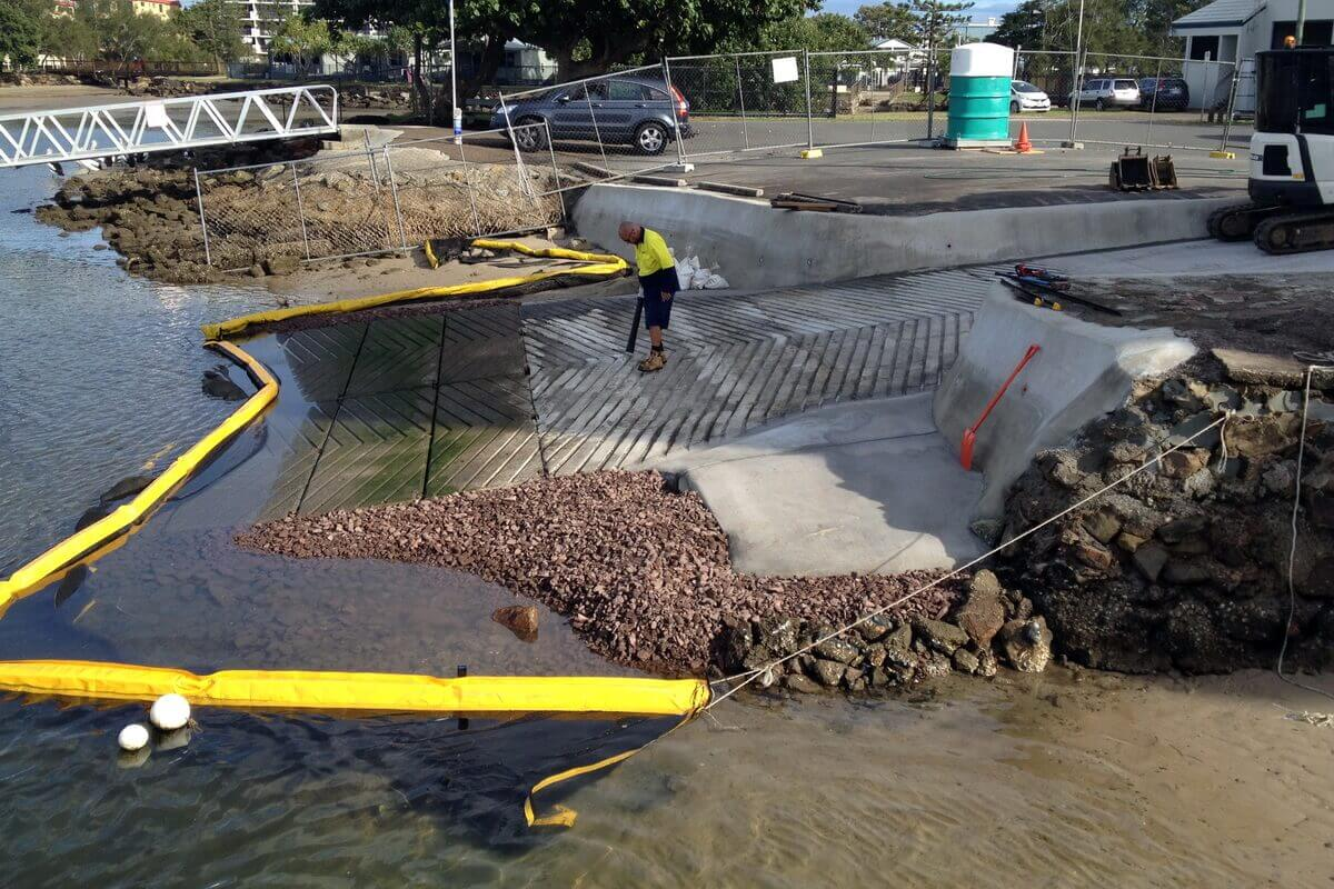 Workman putting finishing touches on new boat ramp